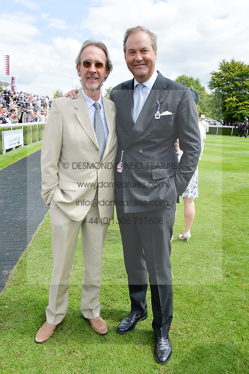 Left to right, MIKE RUTHERFORD and the HON.HARRY HERBERT at the Qatar Goodwood Festival - Ladies Day held at Goodwood Racecourse, West Sussex on 30th July 2015.