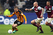 Hull City forward Jarrod Bowen (20) goes round Aston Villa defender Alan Hutton (21)  during the EFL Sky Bet Championship match between Hull City and Aston Villa at the KCOM Stadium, Kingston upon Hull, England on 31 March 2018. Picture by Mick Atkins.