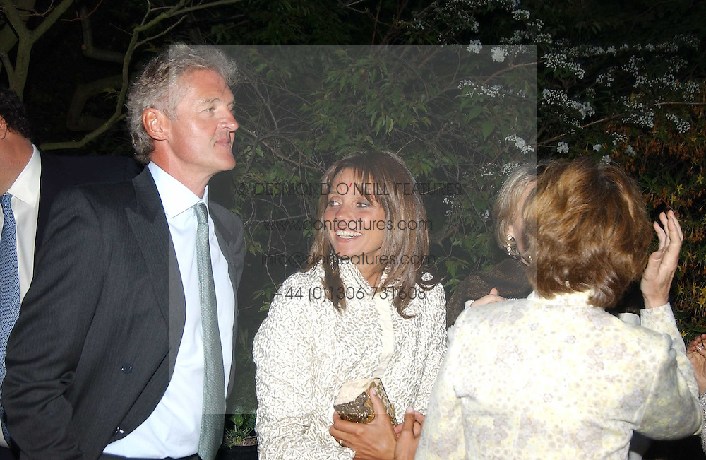 COUNT & COUNTESS LEOPOLD VON BISMARCK at the Cartier Chelsea Flower Show dinat the annual Cartier Flower Show Diner held at The Physics Garden, Chelsea, London on 23rd May 2005.<br />