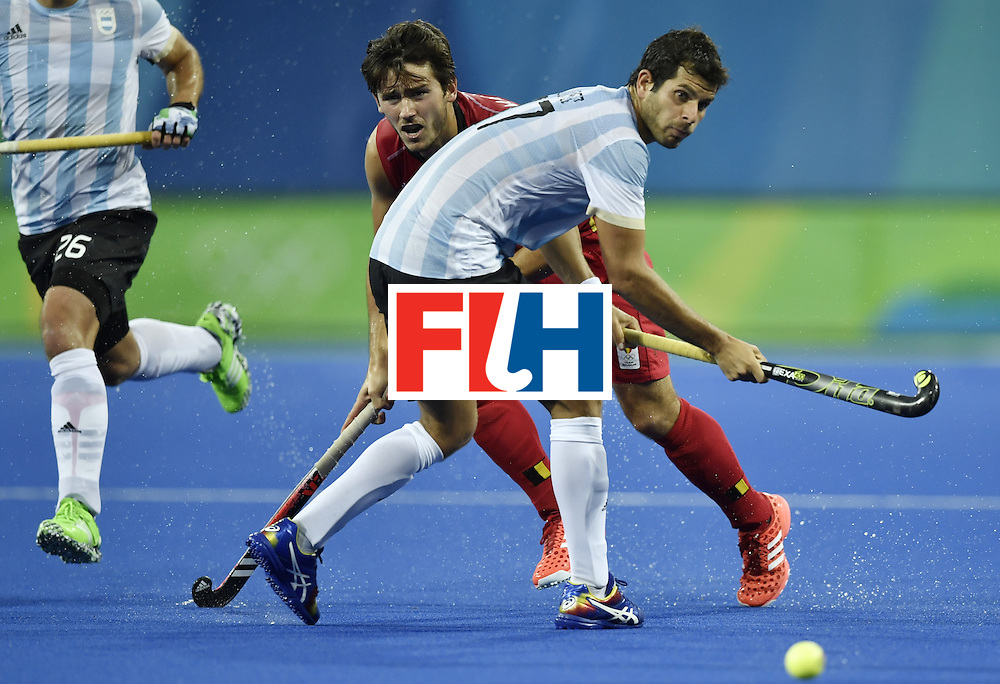 Belgium's Arthur van Doren (L) vies with Argentina's Juan Lopez during the men's Gold medal field hockey Belgium vs Argentina match of the Rio 2016 Olympics Games at the Olympic Hockey Centre in Rio de Janeiro on August 18, 2016. / AFP / PHILIPPE LOPEZ        (Photo credit should read PHILIPPE LOPEZ/AFP/Getty Images)