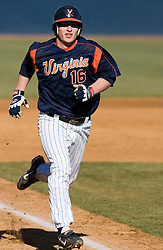 Virginia Cavaliers catcher Beau Seabury (16) runs home to score a run against Delaware.  The Virginia Cavaliers Baseball Team defeated the Delaware Blue Hens 3-2 to complete the sweep of a three game series at Davenport Field in Charlottesville, VA on March 4, 2007.