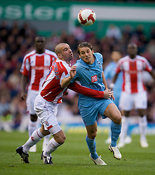 STOKE, ENGLAND - Sunday, October 19, 2008: Tottenham Hotspur's Danny Higgingbotham and Stoke City's David Bentley during the Premiership match at the Britannia Stadium. (Photo by David Rawcliffe/Propaganda)