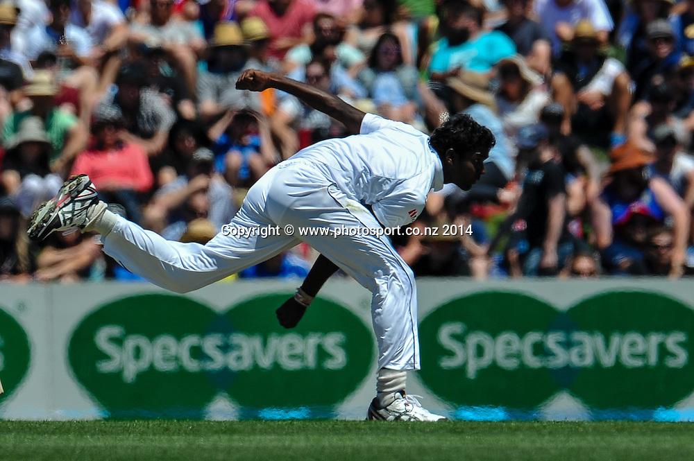 Shaminda Eranga of Sri Lanka bowling  in the 1st day of the cricket test match, NZ v Sri Lanka, Hagley Oval, 26 December 2014. Photo:John Davidson/www.photosport.co.nz