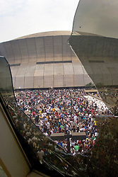01 Sept, 2005. New Orleans, Louisiana.<br /> Thousands of desperate people mass outside the Superdome in the baking heat hoping for a seat on a bus to take them out of town to safety. <br /> Photo©; Charlie Varley/varleypix.com