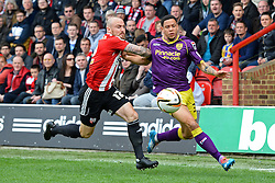 Brentford's midfielder Alan McCormack and Notts County's defender Alan Sheehan compete for the ball   - Photo mandatory by-line: Mitchell Gunn/JMP - Tel: Mobile: 07966 386802 05/04/2014 - SPORT - FOOTBALL -  Griffin Park - London - Brentford v Notts County- Sky Bet League One