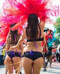 Women dancing in the streets at the 2013 Notting Hill Carnival in West London, United Kingdom. Monday, 26th August 2013. Picture by Nils Jorgensen / i-Images