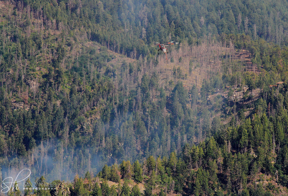 Helicopter hovering over a fire on the North side of Mt. Lemmon