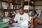 Managing the drug store in a converted shipping container at the Bwindi Community Hospital in the village of Buhoma, Uganda.  The Bwindi Community Hospital is in Buhoma Village on the edge of the Bwindi Impenetrable Forest in Western Uganda. It serves around 250 000 people from the surrounding area.