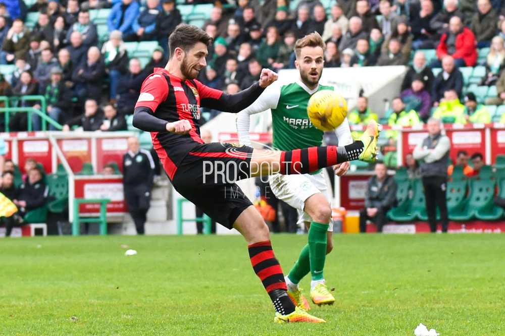 Stuart Carsewell makes clearance in box as Andrew Shinnie attacks during the Ladbrokes Scottish Championship match between Hibernian and Dumbarton at Easter Road, Edinburgh, Scotland on 18 March 2017. Photo by Kevin Murray.