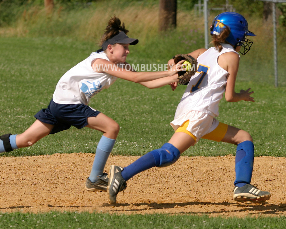 An infielder reaches to tag out a baserunner during the Independence Blast 12 and under girls' softball tournament at Watts Park in Middletown, N.Y., July 9, 2005.