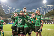 The Scunthorpe United players celebrate scoring the equaliser to make it 1-1 during the EFL Sky Bet League 1 match between Bolton Wanderers and Scunthorpe United at the Macron Stadium, Bolton, England on 31 December 2016. Photo by Mark P Doherty.