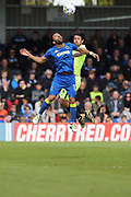 Peterborough United midfielder Michael Bostwick (4) and AFC Wimbledon striker Andy Barcham (17) during the EFL Sky Bet League 1 match between AFC Wimbledon and Peterborough United at the Cherry Red Records Stadium, Kingston, England on 17 April 2017. Photo by Stuart Butcher.