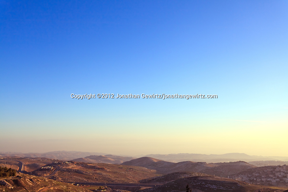 Roads and housing development in the hills east of Jerusalem. WATERMARKS WILL NOT APPEAR ON PRINTS OR LICENSED IMAGES.