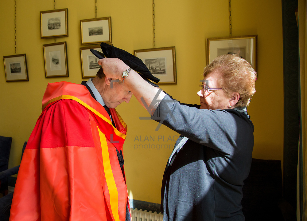 26.04.2017.          <br /> The University of Limerick today conferred Honorary Doctorates on two exceptional individuals from the worlds of business and education, Sr. Angela Bugler and Vincent Roche.&nbsp; <br /> Pictured is Vincent  Roche, President and CEO of Analog Devices Worldwide, who was conferred with an honorary degree of Doctor of Engineering being helped with his robes by Rose Ryan, Phelan Conan Robe Company at the ceremony. Picture: Alan Place.