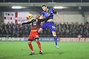 AFC Wimbledon defender Chris Robertson (34) nd Coventry City striker Marcus Tudgay (20) during the EFL Sky Bet League 1 match between AFC Wimbledon and Coventry City at the Cherry Red Records Stadium, Kingston, England on 14 February 2017. Photo by Stuart Butcher.