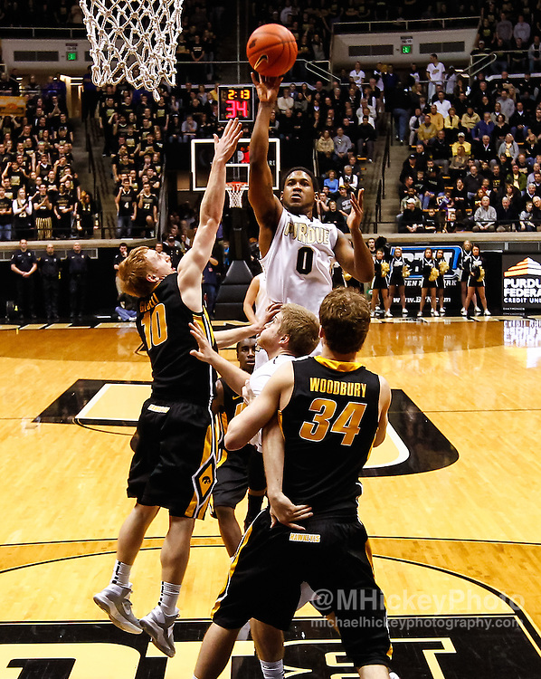 WEST LAFAYETTE, IN - JANUARY 27: Terone Johnson #0 of the Purdue Boilermakers shoots the ball against Mike Gesell #10 of the Iowa Hawkeyes at Mackey Arena on January 27, 2013 in West Lafayette, Indiana. (Photo by Michael Hickey/Getty Images) *** Local Caption *** Terone Johnson; Mike Gesell