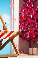Pink christmas tree in beach storage cabin