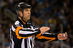 April 29, 2010; San Jose, CA, USA;  NHL referee Eric Furlatt during the second period of game one of the western conference semifinals of the 2010 Stanley Cup Playoffs between the San Jose Sharks and the Detroit Red Wings at HP Pavilion. San Jose defeated Detroit 4-3. Mandatory Credit: Jason O. Watson / US PRESSWIRE