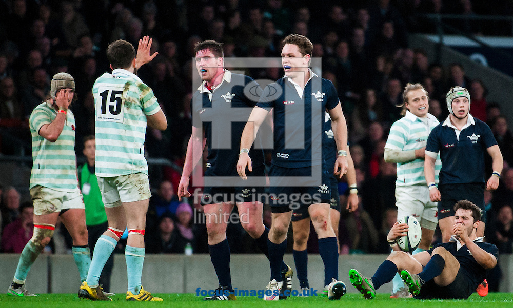 Simon Davis of Cambridge University is confronted by Oxford players after tackling Henry De Berker of Oxford University while he was in the air during the The Mens Varsity Match match at Twickenham Stadium, Twickenham<br /> Picture by Jack Megaw/Focus Images Ltd +44 7481 764811<br /> 10/12/2015