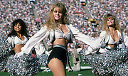 Three Los Angeles Raiders cheerleaders perform during the NFL football game between the Atlanta Falcons and the Oakland Raiders on November 20, 1988 in Los Angeles, California. The Falcons won the game 12-6. ©Paul Anthony Spinelli