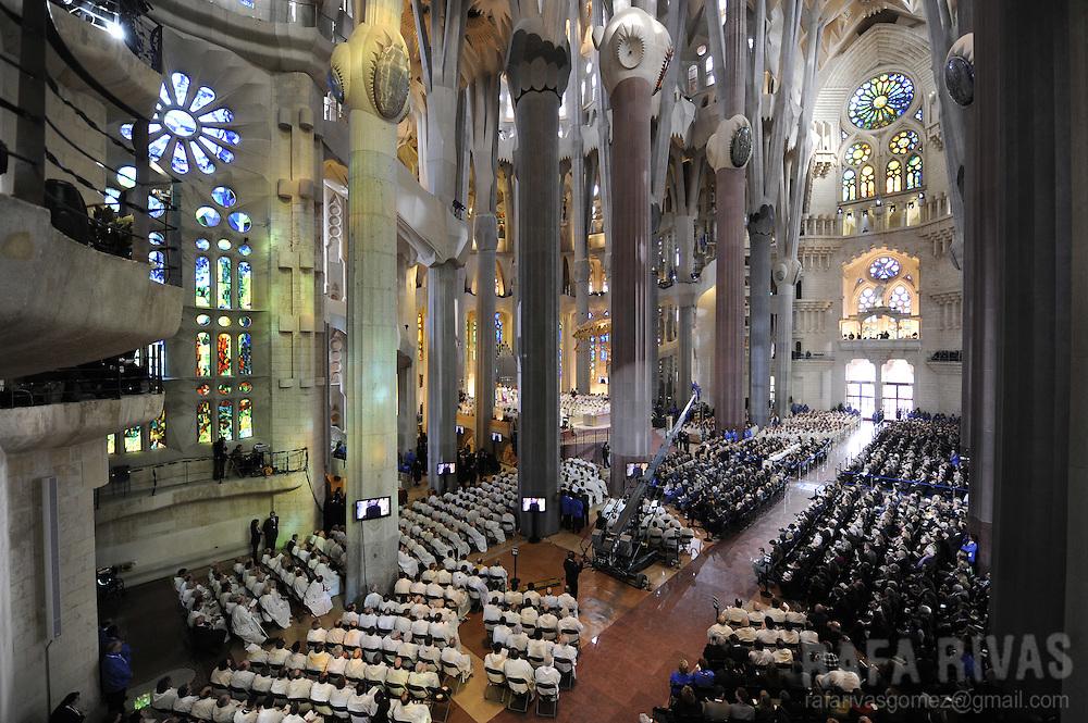 Priests attend a mass celebrated by Pope Benedict XVI, to consecrate Barcelona's famous temple, the Sagarada Famila church, on november 7, 2010, in Barcelona. PHOTO/Rafa Rivas
