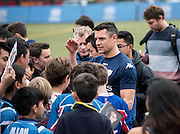 Fly-Half DAN CARTER of French rugby union team, Racing 92 from Paris, swamped by fans after training in Hong Kong. They are preparing ahead of their upcoming match against New Zealand's Super League team, The Highlanders