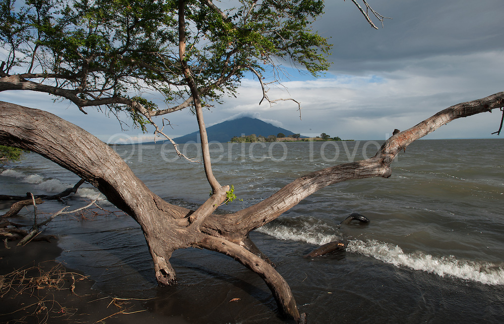 The Maderas volcano seen from the pristine beach of the reserve Charco Verde. Ometepe Island