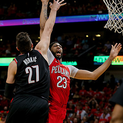 Apr 21, 2018; New Orleans, LA, USA; New Orleans Pelicans forward Anthony Davis (23) is shoots over Portland Trail Blazers center Jusuf Nurkic (27) during the fourth quarter in game four of the first round of the 2018 NBA Playoffs at the Smoothie King Center.  Pelicans defeated the Trail Blazers 131-123 sweeping the series and advancing to the western conference semi-finals.  Mandatory Credit: Derick E. Hingle-USA TODAY Sports