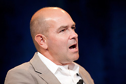 Chris Anderson, editor-in-chief of Wired magazine, moderates  a CEO roundtable discussion at the annual VMworld conference in San Francisco, California.