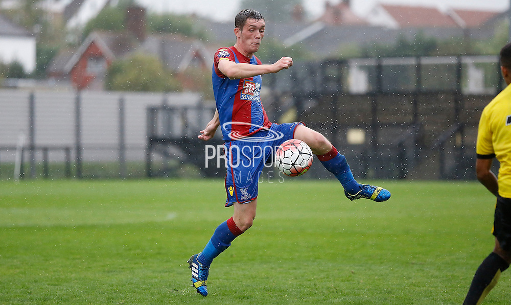 Connor Dymond intercepting the ball during the Final Thirds Development League match between U21 Crystal Palace and U21 Watford at Selhurst Park, London, England on 24 August 2015. Photo by Michael Hulf.