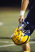 Milpitas High School senior, CJ Reyes (32), holds his helmet on the sideline during the fourth quarter of the Oct. 5, 2012, home game against Mountain View.  The Trojans would go on to win 42-7.  Photo by Stan Olszewski/SOSKIphoto.