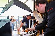 Mannheim. 09.05.18 | <br /> Küchenparty im Sternerestaurant Opus V.<br /> Vorstellung des Radio Regenbogen Harald Wohlfahrt Palazzo Jubiläumsmenüs.<br /> 20 Jahre Palazzo und 18 Jahre unter der Küchenregie von Harald Wohlfahrt mit seinen innovativen und qualitativ hochwertigen Kreationen. Mittlerweile hat sich die Spielzeit wegen der großen Resonanz von sechs Wochen auf viereinhalb Monate verlängert.<br /> Harald Wohlfahrt stellt nun im  Sternerestaurant Opus V im Dachgeschoss des Hauses engelhorn mode das Menü für die neue Spielzeit vor.<br /> Als Vorspeise gibt es Anis gebeizter Lachs mit marinierten Belugalinsen auf Mango-Papaya-Chutney. Der zweite Gang. Ein Spieß von Garnele und Jakobsmuschel an einer leichten Curry Velouté und Cocobohnen. Es folgt als Hauptgang ein Duett von der Barberie Ente auf Rahmwirsing, eingelegten Backpflaumen und Kartoffelsoufflé. Krönender Abschluss des Jubiläumsmenüs ist eine Panna Cotta an exotischem Fruchtsalat mit Himbeerbiskuit und Mangosorbet.<br /> - Harald Wohlfahrt und Tristan Brandt richten das Essen für das Katalogshooting an<br /> <br /> Bild: Markus Prosswitz 09MAY18 / masterpress (Bild ist honorarpflichtig - No Model Release!) <br /> BILD- ID 00223 |