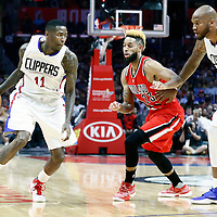 09 November 2016: Los Angeles Clippers guard Jamal Crawford (11) drives past Portland Trail Blazers guard Allen Crabbe (23) on a screen set by Los Angeles Clippers center Marreese Speights (5) during the LA Clippers 111-80 victory over the Portland Trail Blazers, at the Staples Center, Los Angeles, California, USA.
