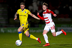 James Clarke of Bristol Rovers takes on Kieran Sadlier of Doncaster Rovers - Mandatory by-line: Robbie Stephenson/JMP - 26/03/2019 - FOOTBALL - Keepmoat Stadium - Doncaster, England - Doncaster Rovers v Bristol Rovers - Sky Bet League One