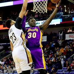 Nov 12, 2016; New Orleans, LA, USA;  Los Angeles Lakers forward Julius Randle (30) shoots over New Orleans Pelicans forward Anthony Davis (23) during the first quarter of a game at the Smoothie King Center. Mandatory Credit: Derick E. Hingle-USA TODAY Sports
