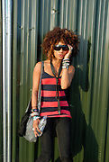 Cute girl with bangles, big sunglasses and an afro, Metro Weekender, Get Loaded In The Park, London 2006