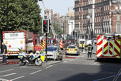 © Licensed to London News Pictures. 06/06/2018. London, UK. Emergency services outside the Mandarin Oriental hotel during a fire. Fifteen fire engines and 97 firefighters and officers have been called to a fire believed to be at the Mandarin Hotel in Kightsbridge. Photo credit: Peter Macdiarmid/LNP