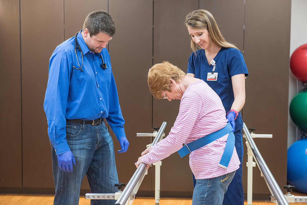 Family Medicine doctor Samuel Kreis, MD, photographed working with patient Shirley Morgan and Physical Therapist Devon Burchett, Friday, May 22, 2015 at Baptist Health in Corbin, Ky. (Photo by Brian Bohannon/Videobred for Baptist Health)