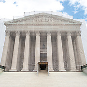 While the US Supreme Court building is undergoing renovations, it is covered with a light scrim over the scaffolding that shows an image of the building as it was before the repairs and without the scaffolding.