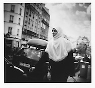 Elegant Maghrebi women wears a hijab headscarf, Belleville, Paris, France.