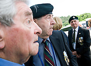 Korean War veteran Robison Brown (2 left) chats with other British veterans prior to a commemorative event to mark the 60th anniversary of the start of the Korean War at the National Cemetery in Seoul, South Korea on 23 June, 2010..Photographer: Rob Gilhooly .