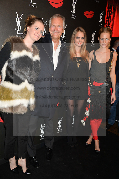 Left to right, CHLOE DELEVINGNE, CHARLES DELEVINGNE, CARA DELEVINGNE and POPPY DELEVINGNE at the YSL Beauty: YSL Loves Your Lips party held at The Boiler House,The Old Truman Brewery, Brick Lane,London on 20th January 2015.