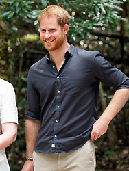 The Duke of Sussex visits the K'gari rainforest on Fraser Island, Australia. The Duke unveiled a plaque for the dedication of the forests to the Queen's Commonwealth Canopy. The proud Duke even folded up the material that was covering the plaque before watching traditional dances by the Butchulla people.<br /><br />22 October 2018.<br /><br />Please byline: Vantagenews.com