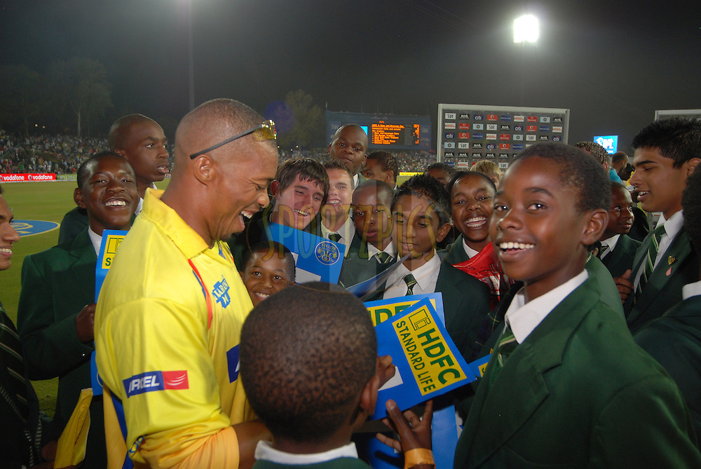 CENTURION, SOUTH AFRICA - 30 April 2009.  Local hero Makhaya Ntini hands out autographs during the IPL Season 2 match between the Rajasthan Royals and the Chennai Superkings held at Centurion, South Africa.