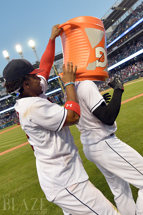 Sep 4, 2016; Cleveland, OH, USA; Cleveland Indians shortstop Francisco Lindor (12) puts a bucket of gatorade on Cleveland Indians right fielder Lonnie Chisenhall (8) after Chisenahll hit a game winning single during the ninth inning to beat the Miami Marlins 6-5 at Progressive Field. Mandatory Credit: Ken Blaze-USA TODAY Sports