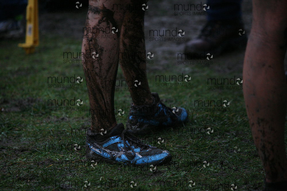 (Vancouver, Canada---26 November 2011) muddy shoes and legs at the 2011 Athletics Canada National Cross Country Championships held at Jericho Beach Park. Photograph 2011 Copyright Sean Burges / Mundo Sport Images. For usage terms contact info@mundosportimages.com or seanburges@yahoo.com.