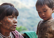 The tattooed women of Burma: Extraordinary photographs show elaborate facial inkings of the tribe whose traditions are dying out<br /> <br /> Their faces covered in elaborate black patterns and, in some cases, totally dark with ink, these smiling villagers are some of Burma's last surviving tattooed women.<br /> <br /> A custom that, according to legend, began when an ancient king tried to make slaves of the women, the inkings were first intended to repel incomers and then became a symbol of beauty.<br /> But with younger people increasingly reluctant to be inked for fear of ridicule and for fear of the heavy fines imposed by the ruling military junta, Burma's tattooing tradition is on borrowed time and could disappear within a generation.<br /> <br /> As a result, few women now have the markings, with the majority of those who do living hidden away in the mountainous Chin, Rakhine and Arakan regions - all of which were closed off to visitors until two years ago.<br /> <br /> Now an estimated 700 tourists travel to the area each year, although few are inclined to attempt the precipitous climb up to the mountain eyries of the Magan, Chin and Muun tribes.<br /> Those who do will be rewarded with a warm welcome - and a glimpse into one of Asia's oldest, and most threatened, cultures.&nbsp;<br /> Most of the tattooed women boast spider's web designs which, as one villager quipped 'attract the men like a spider's web catches insects'.<br /> Others bear full-face tattoos, with every part of their face covered in ink - again, a symbol of beauty. So popular did the look become, one elderly lady, Pa Late from the remote Kanpelet village, revealed that women who chose not to have it 'looked ugly to all the men'.<br /> <br /> The tattoos, which are created using thorn needles and an ink made from a mixture of cow bile, soot, plants and pig fat, are also a sign of bravery - particularly those etched on the neck, which are the most painful of all.&nbsp;<br /> In the past, women 