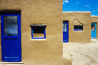 Adobe houses with blue windows and door frames