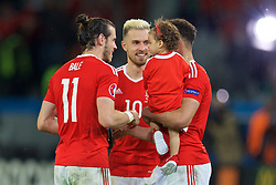 LILLE, FRANCE - Friday, July 1, 2016: Wales' Gareth Bale, Hal Robson-Kanu and his daughter, Aaron Ramsey after the 3-1 victory over Belgium during the UEFA Euro 2016 Championship Quarter-Final match at the Stade Pierre Mauroy. (Pic by David Rawcliffe/Propaganda)