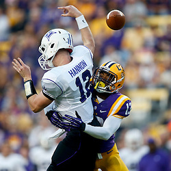 Oct 26, 2013; Baton Rouge, LA, USA; LSU Tigers cornerback Dwayne Thomas (13) hits Furman Paladins quarterback Reese Hannon (12) as he throws to cause an incomplete pass during the first quarter of a game at Tiger Stadium. Mandatory Credit: Derick E. Hingle-USA TODAY Sports